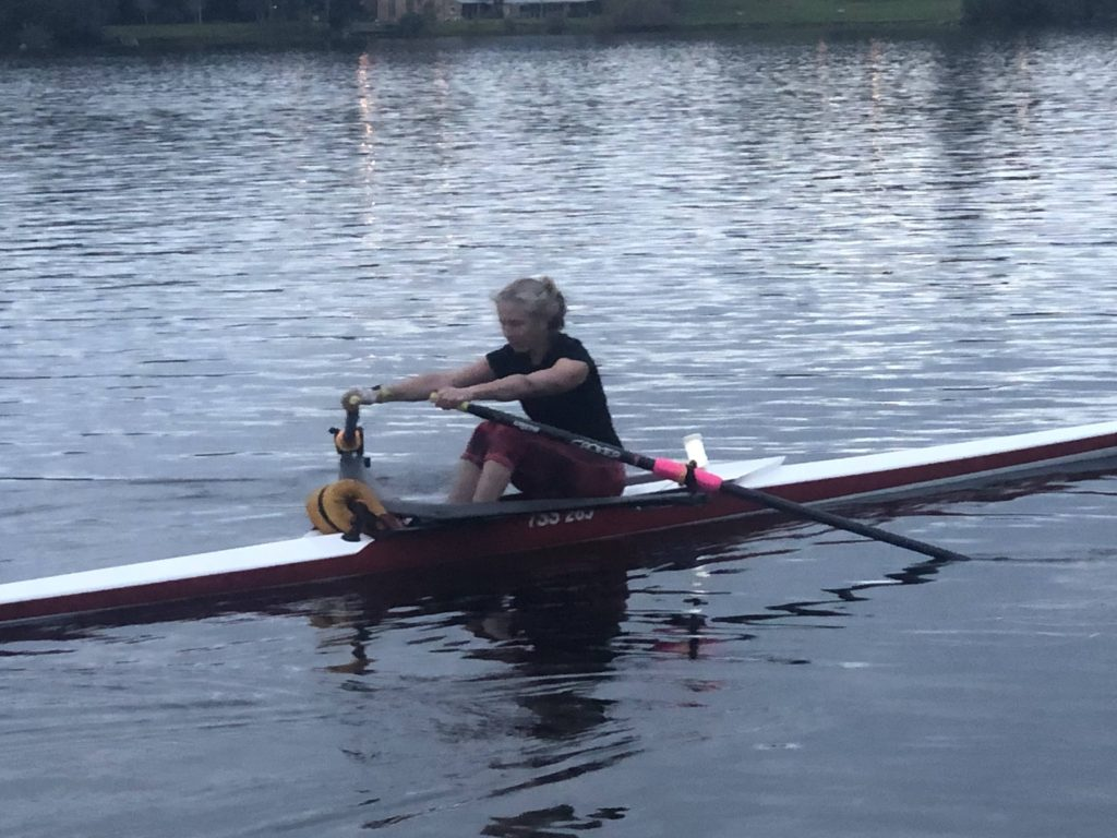 competitive woman sculler